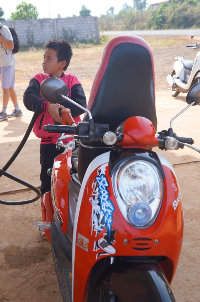 Only in Laos will an 8-year-old pump your gas